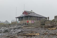 The Rest Bay Lifeguard Station. Rest Bay Lifeguard station, Porthcawl,South Wales, UK, on a cold February morning royalty free stock image