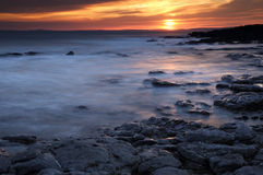 Rest Bay, Porthcawl, South Wales. Sunset at Rest Bay, Porthcawl, South Wales, during the warm weather enjoyed by the UK royalty free stock images