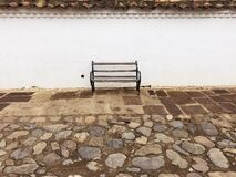 Rest on bench. Benches are different and charming.