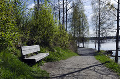 Rest bench. Wooden rest bench near the river, from the North of Sweden Stock Image
