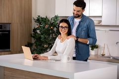 Cheerful loving husband massaging the shoulders royalty free stock images