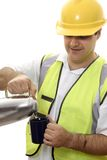 Rest Break. Worker pours water from a flask into a mug Stock Image