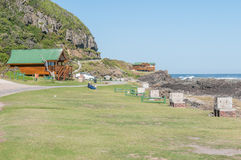 Rest camp at Storms River Mouth. STORMS RIVER MOUTH, SOUTH AFRICA - FEBRUARY 28, 2016:  Unidentified tourists in front of chalets at the rest camp at Storms Royalty Free Stock Image