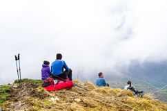 Rest in the Caucasian mountains. Group of four people from Nizhny Novgorod during the break in their hiking trip in Caucasian mountain slope in may 2016 Stock Photos
