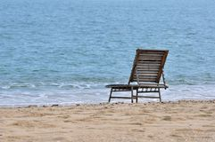 Rest chair on sea sand Stock Photography