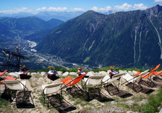 Rest chairs in the mountains above Chamonix valley. Colorful rest chairs in the mountain cafe above Chamonix Mont Blanc village, France Stock Images