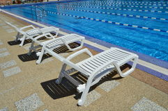 Rest chairs by the pool. Stock Photography