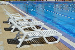 Rest chairs by the pool. Royalty Free Stock Photo