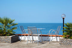 Rest on coast. Table and chairs on beach Royalty Free Stock Images