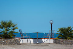Rest on coast. Table and chairs on beach Stock Photography