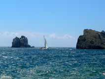 Rest in Crimea. Sailing vessel between two rocks Royalty Free Stock Photography