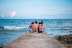 Rest. Family having some rest after swimming, rear view Royalty Free Stock Photos