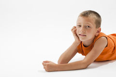 Rest on the floor. Little boy resting on the floor and smiling at camera Stock Photography