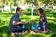 Rest in garden. Young men and girl on picnic in garden Stock Photo