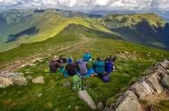 Rest group of tourists on top of the mountain. Carpathians mountain stock photos