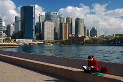 Rest at a harbour. Woman has a rest in the middle of the day at Cirqular Quay in Sydney Harbour royalty free stock photo