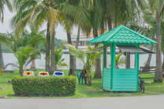 Rest home of guard security staff with coconut palm trees background. Royalty Free Stock Photos