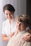 Rest home resident and carer. Picture of rest home resident and professional carer Stock Photos