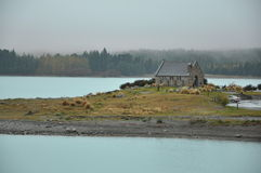 Rest at lake. A lazy day in a blue lake and church Stock Images