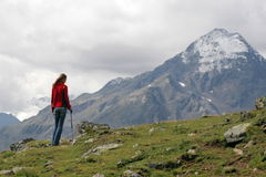Rest after a long walk. Young woman hiker having a rest after long walk in mountains Stock Photos