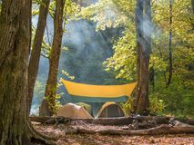 Useful rest in tents in the wild. Rest in the mountains in the fresh air with tents and a fire. Pleasant and useful weekend Stock Photography