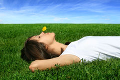 Rest with nature. Young woman on the herb Stock Image