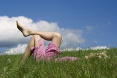 Rest on the nature II. The nice girl  laying on  the grass Royalty Free Stock Images