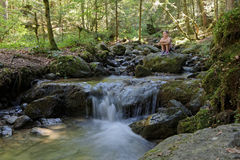 Rest over the small waterfall Stock Photography