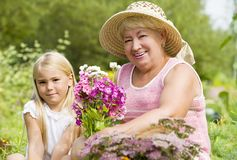 Rest in the park. Grandma and her grandchild have a rest in the park Royalty Free Stock Photography