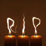 Rest in peace - RIP. Modified photo of three candles. Flames write letters RIP - rest in peace Royalty Free Stock Photography