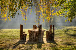 Rest place. Place for rest with hand made table and chairs in a beautiful park Royalty Free Stock Image