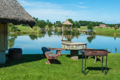 Rest place on the lake coast. A barbecue picnic at lithuanian lake Stock Photos