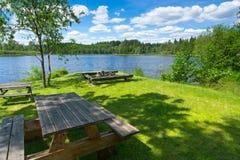 Rest place on the lake coast. Rest place a Swedish lake coast Stock Photos