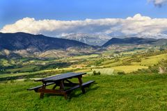 Rest place with mountains on the background. Beautiful rest place in the French Alps with view on mountains and valley Stock Image