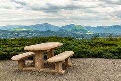 Rest place in Provence. Rest place with table and benches and view on mountains and valley in Provence Royalty Free Stock Image