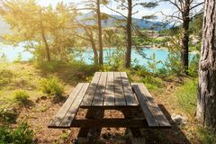 Rest place near a beautiful lake. Rest place, table and benches near a beautiful lake in France Stock Photography