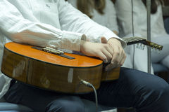Rest after playing acoustic guitar Royalty Free Stock Image