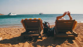 Rest on the Red Sea, the Girl on a Lounger Overlooking the Sea stock footage