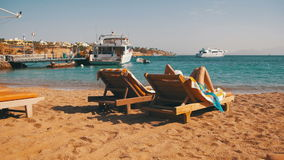 Rest on the Red Sea, the Girl on a Lounger Overlooking the Sea in Egypt. EGYPT, SOUTH SINAI, SHARM EL SHEIKH, DECEMBER 7, 2016: Woman sunbathing on a lounger stock video
