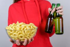Rest relax chill alcohol concept. Cropped closeup carefree careless positive glad nice lady holding full large big rice rings in. Hand and two bottles isolated royalty free stock photos