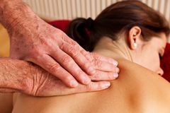 Rest and relaxation through massage Royalty Free Stock Image