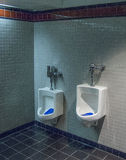 Rest room with two size urinals Stock Image