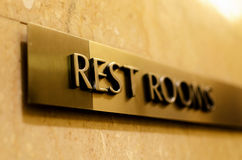 Rest Rooms. Brass sign typically found in hotels, restaurants, shopping malls, etc royalty free stock photos
