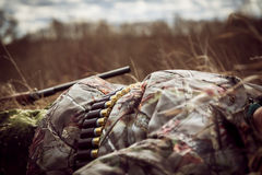 Rest in rural field at sunset after  hunting day Royalty Free Stock Image