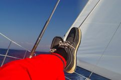 Rest at sailing. Finding comfortable position at sailing - legs resting Stock Image