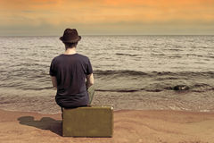Rest by the sea .The man with a suitcase on a beach in vacation Stock Photography