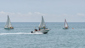 Rest on sea. Motor boat, boats with sail. Outdoor sea sporting activity Stock Photos