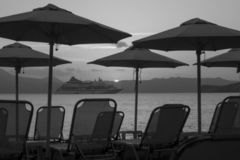Rest on the shore and on a cruise ship black and white photo. Rest on the shore and on a large cruise ship black and white photo royalty free stock photography