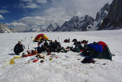 Rest on the snow lake. Atmosphere of relaxation in the midle of nowhere very far away from civilization, karakoram himalaya, biafo hispar traverse Royalty Free Stock Photos