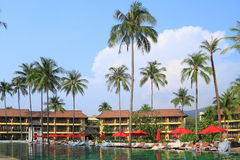 Rest under palm trees in hotel of Thailand Royalty Free Stock Images